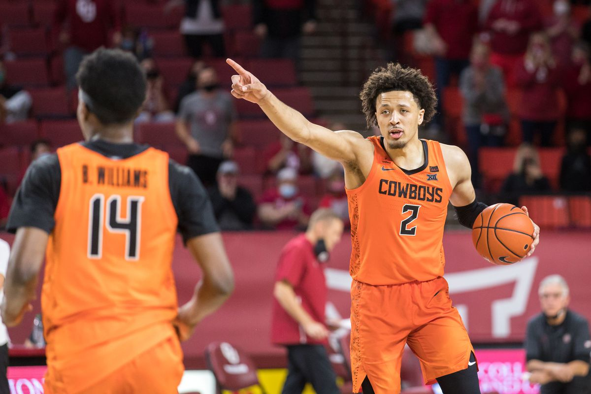 Oklahoma State Cowboys guard Cade Cunningham calls a play during overtime against the Oklahoma Sooners on February 27th, 2021 at Lloyd Noble Center in Norman Oklahoma.