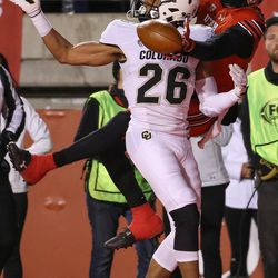 Colorado Buffaloes defensive back Isaiah Oliver (26) is charged with pass interference as he covers Utah Utes wide receiver Darren Carrington II (9) at Rice-Eccles Stadium in Salt Lake City on Saturday, Nov. 25, 2017.