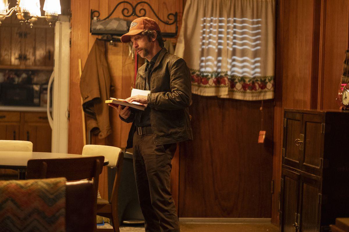 Tim Blake Nelson looks through his mail.