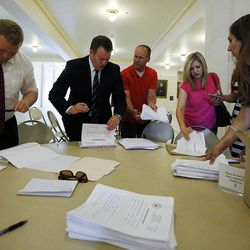 FILE - Volunteers and an advisor to Evan McMullin count signatures at the Capitol in Salt Lake City on Monday, Aug. 15, 2016, for a petition to put McMullin on the presidential ballot in Utah in November. McMullin continues to hit and miss deadlines as his campaign furiously tries to get on election ballots across the country.