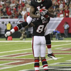 Atlanta Falcons wide receiver Roddy White (84) celebrates with Julio Jones (11) after catching a touchdown pass during the first half of an NFL football game against the Carolina Panthers Sunday, Sept. 30, 2012, in Atlanta.