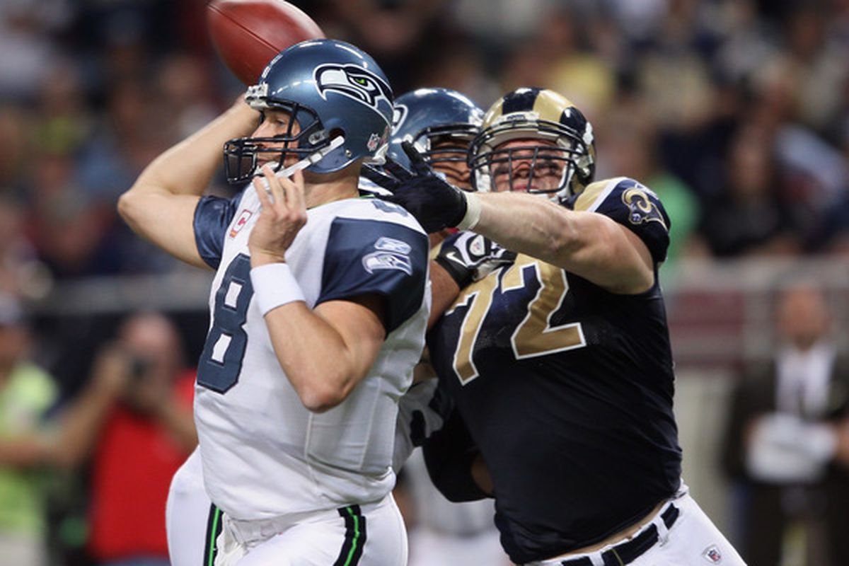 Chris Long of the St. Louis Rams pressures Matt Hasselbeck. A similar greeting awaits a recovering Matt Cassel in today's Rams-Chiefs game.
