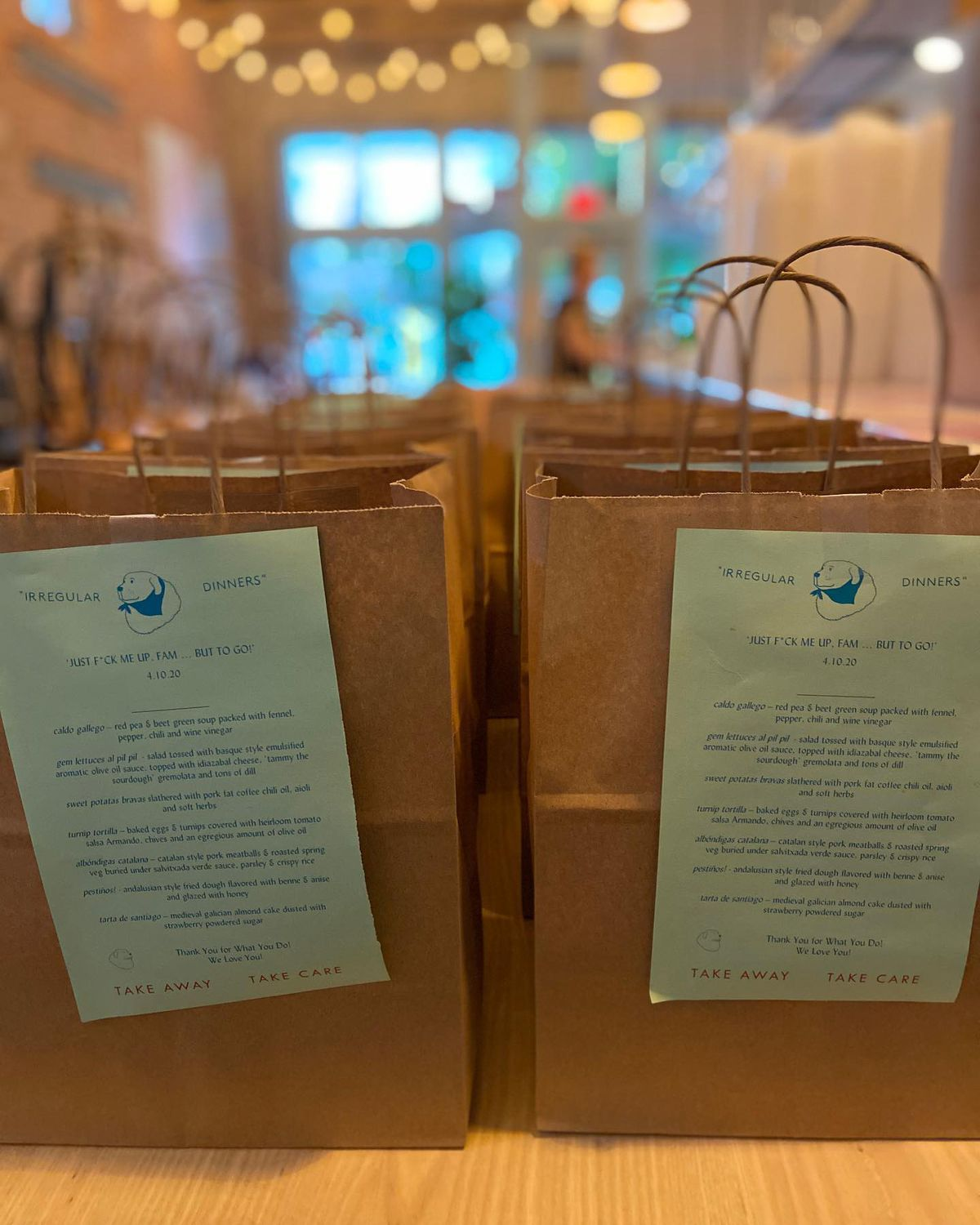 Bags of to-go orders line the bar inside Little Bear on Georgia Avenue in Summerhill