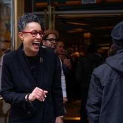 Shauna McKenzie-Lee, managing director of the roastery,welcomes customers to the Starbucks Reserve Roastery on opening day Friday.