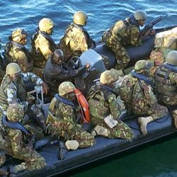 This undated photo provided by Kenya's Ministry for Defence on Friday, Sept. 28, 2012, is said by them to show Kenya Defence Forces troops at an undisclosed location in Kenya, engaged in recent preparations for an assault on the Somali port city of Kismayo. Kenyan troops invaded al-Shabab's last stronghold in Somalia on Friday, coming ashore in a predawn beach landing at Kismayo that appeared likely to deprive the Islamist insurgents of their last big money-making enterprise.