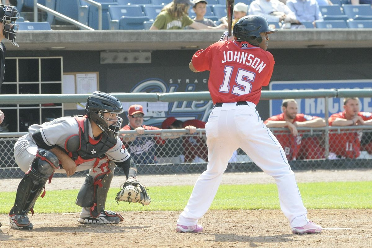 Josh Johnson bats on Mother's Day in pink spikes for the Syracuse Chiefs. Johnson is trying to make it to the big leagues with the Nationals. His father played with the Expos in the 1970s. (Ben Meyers for Federalbaseball.com)