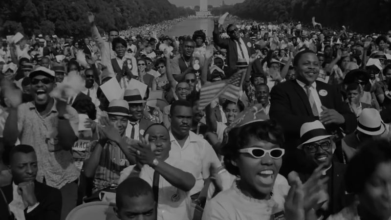 A crowd of Black people stand at one end of the Washington Mall.