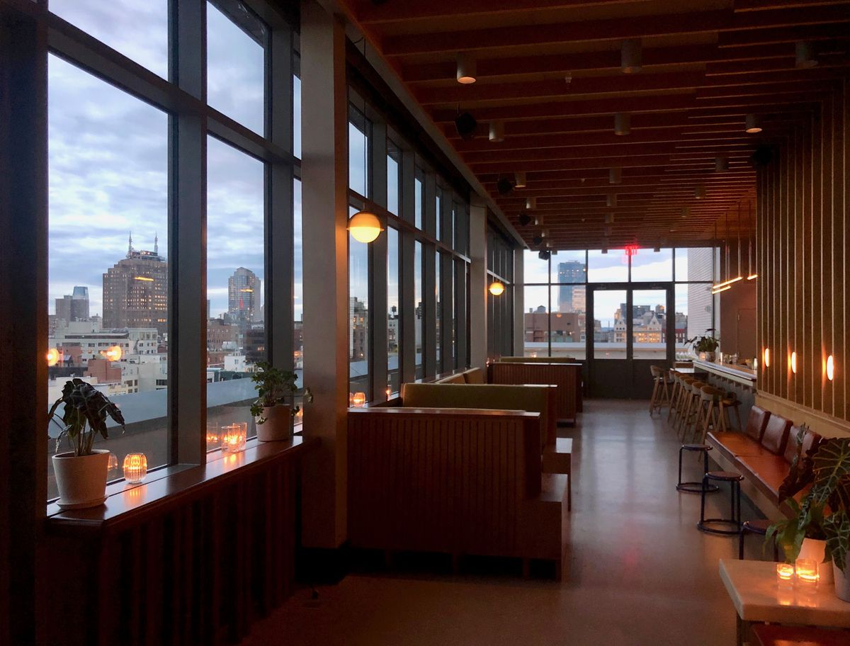 light bar opens  sister city hotel  les  sweeping views eater ny