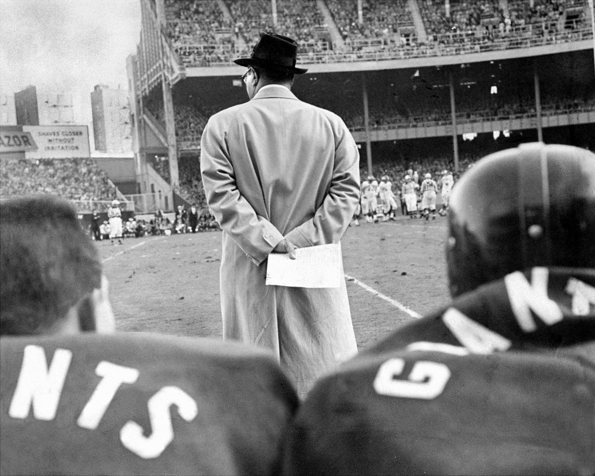 Vince Lombardi of the New York Giants' clutches a play chart