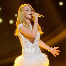 """FILE - In this April 11, 2012 file photo released by Fox, Hollie Cavanagh performs on the singing competition series """"American Idol,"""" in Los Angeles. Cavanagh on Thursday, April 19, 2012 was among the bottom three contestants on the Fox talent competition."""