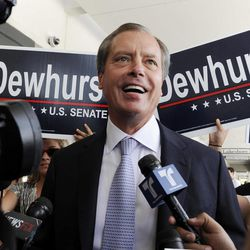 Texas Lt. Gov. David Dewhurst is backed by supporters outside a Houston deli as he answers reporters questions Tuesday, July 31, 2012. Dewhurst faces former Texas Solicitor General Ted Cruz in the Republican primary runoff election for U.S. Senator.