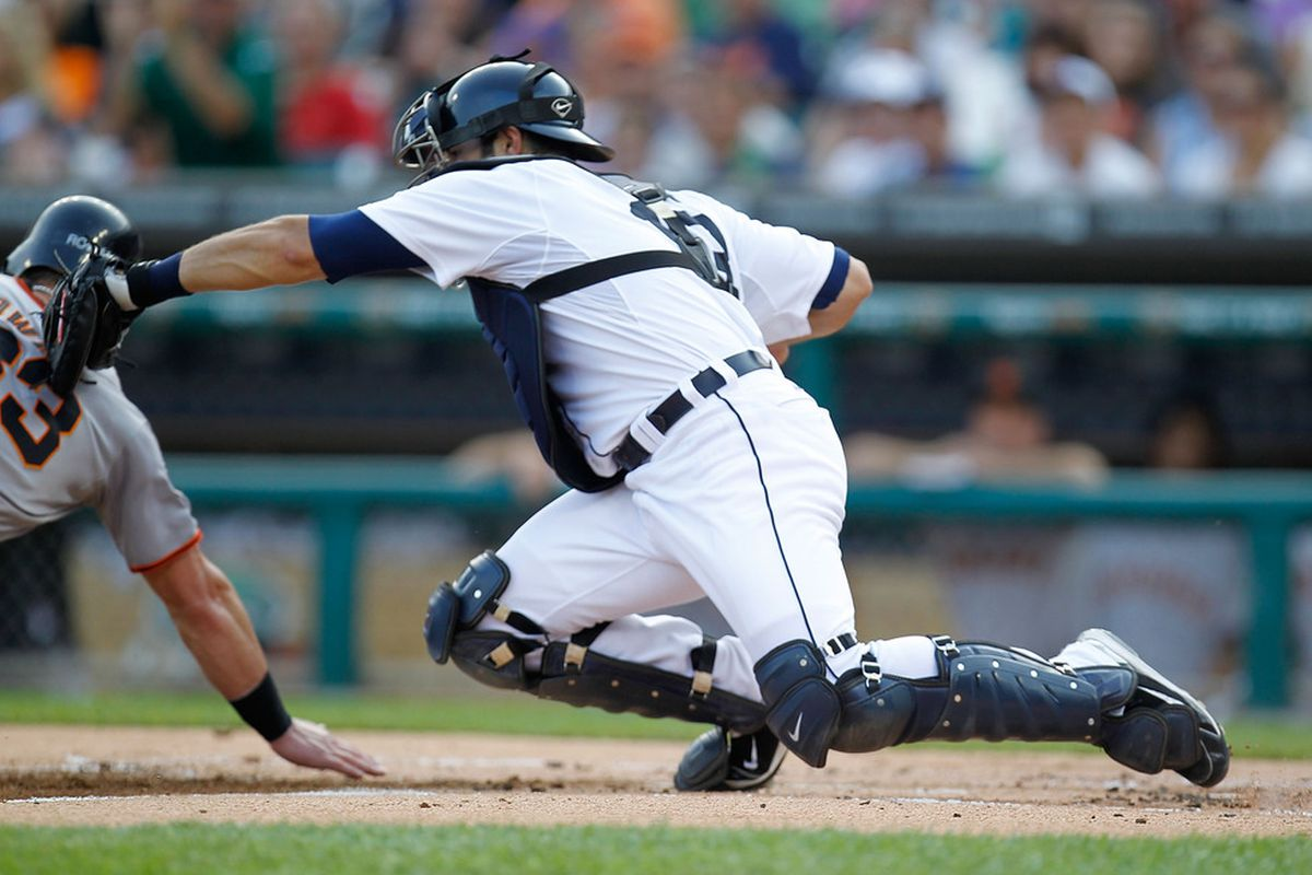 DETROIT, MI - JULY 01: Alex Avila #13 of the Detroit Tigers tags out Aaron Rowand #33 of the San Francisco Giants as he tries to score in the first inning at Comerica Park on July 1,  2011 in Detroit, Michigan. (Photo by Gregory Shamus/Getty Images)