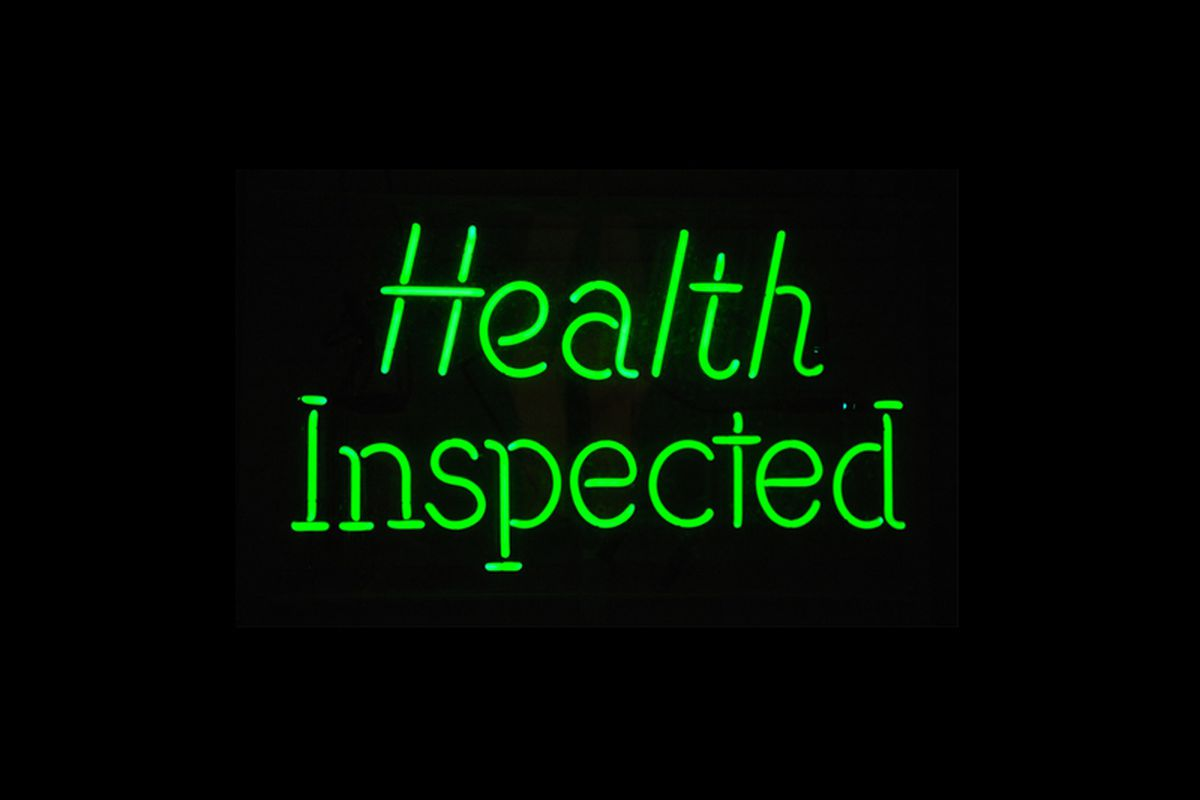 """Neon sign that says """"health inspected"""""""