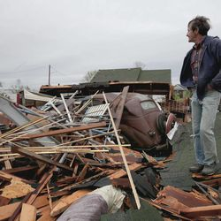 Gary Gladwin looks over his wrecked property where he stored a 1937 Chevy, in Thurman, Iowa, Sunday, April 15, 2012. A large part of the town in the western part of the state was destroyed Saturday night, possibly by a tornado, but no one was injured or killed. Fremont County Emergency Management Director Mike Crecelius said about 75 percent of the 250-person town was destroyed.