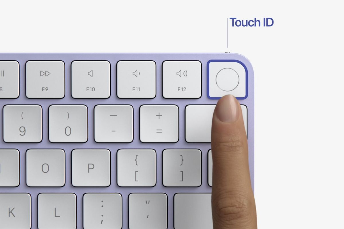 Apple's Magic Keyboard in purple, with a Touch ID button in the top right corner.