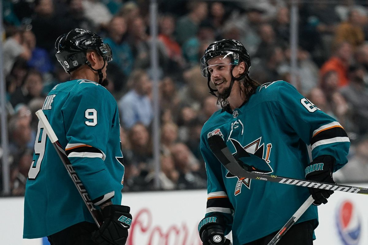 Oct 3, 2018; San Jose, CA, USA; San Jose Sharks left wing Evander Kane (9) converses with defenseman Erik Karlsson (65) and right wing Joonas Donskoi (27) against the Anaheim Ducks during the second period at SAP Center at San Jose.