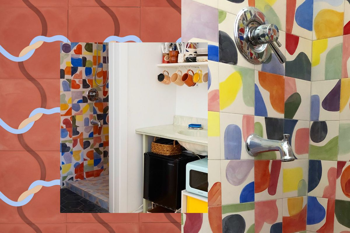 A bathroom tiled with multi-color hand-painted tile