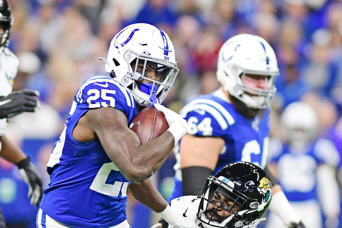 Indianapolis Colts running back Marlon Mack carries the ball as Jacksonville Jaguars corner back D.J. Hayden defends in the first half at Lucas Oil Stadium.