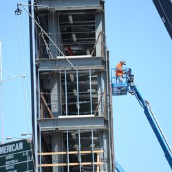 11:23 a.m. Bracing being installed to enclose the back of the right-field video board -