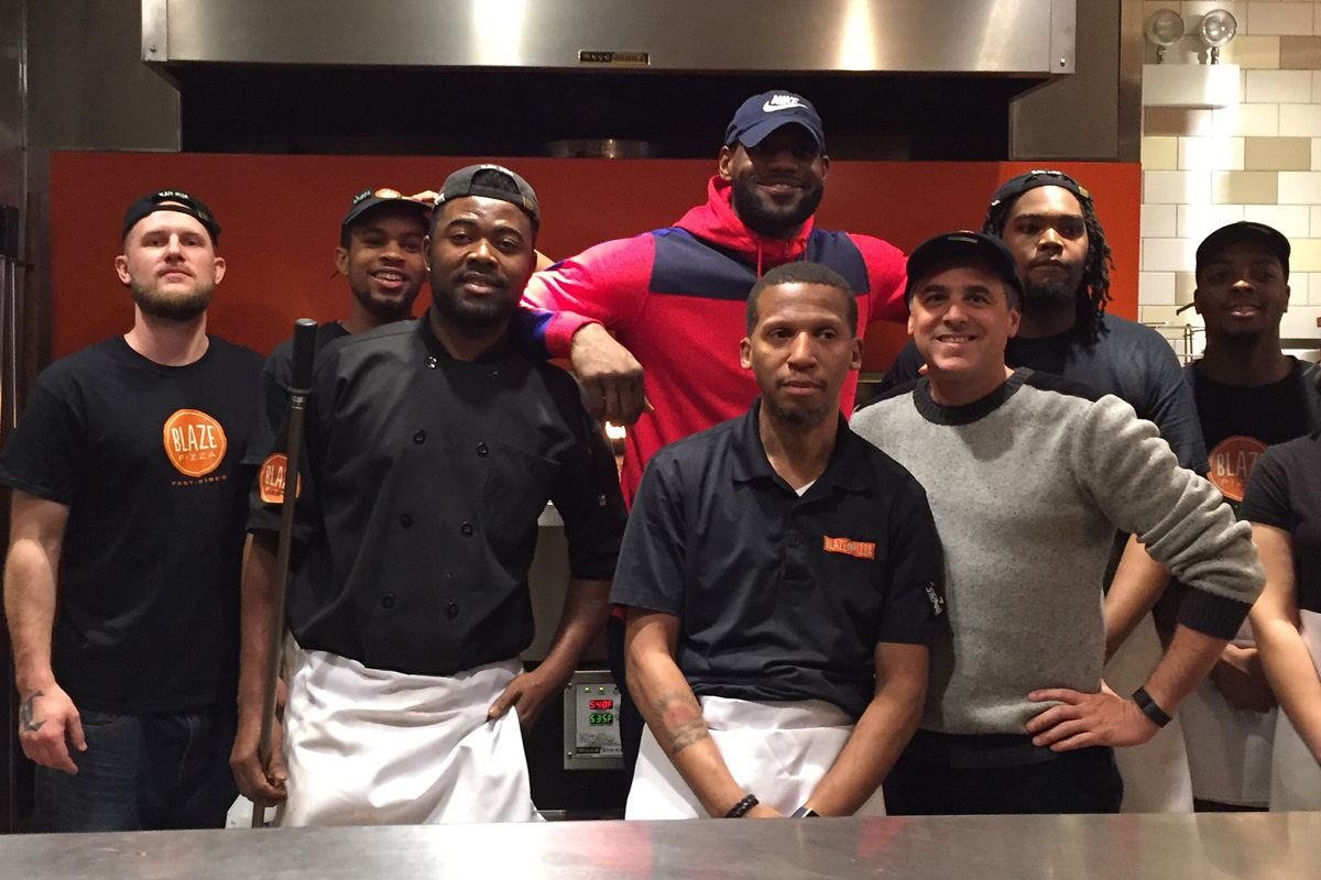 LeBron James poses with Blaze Pizza workers in Streeterville