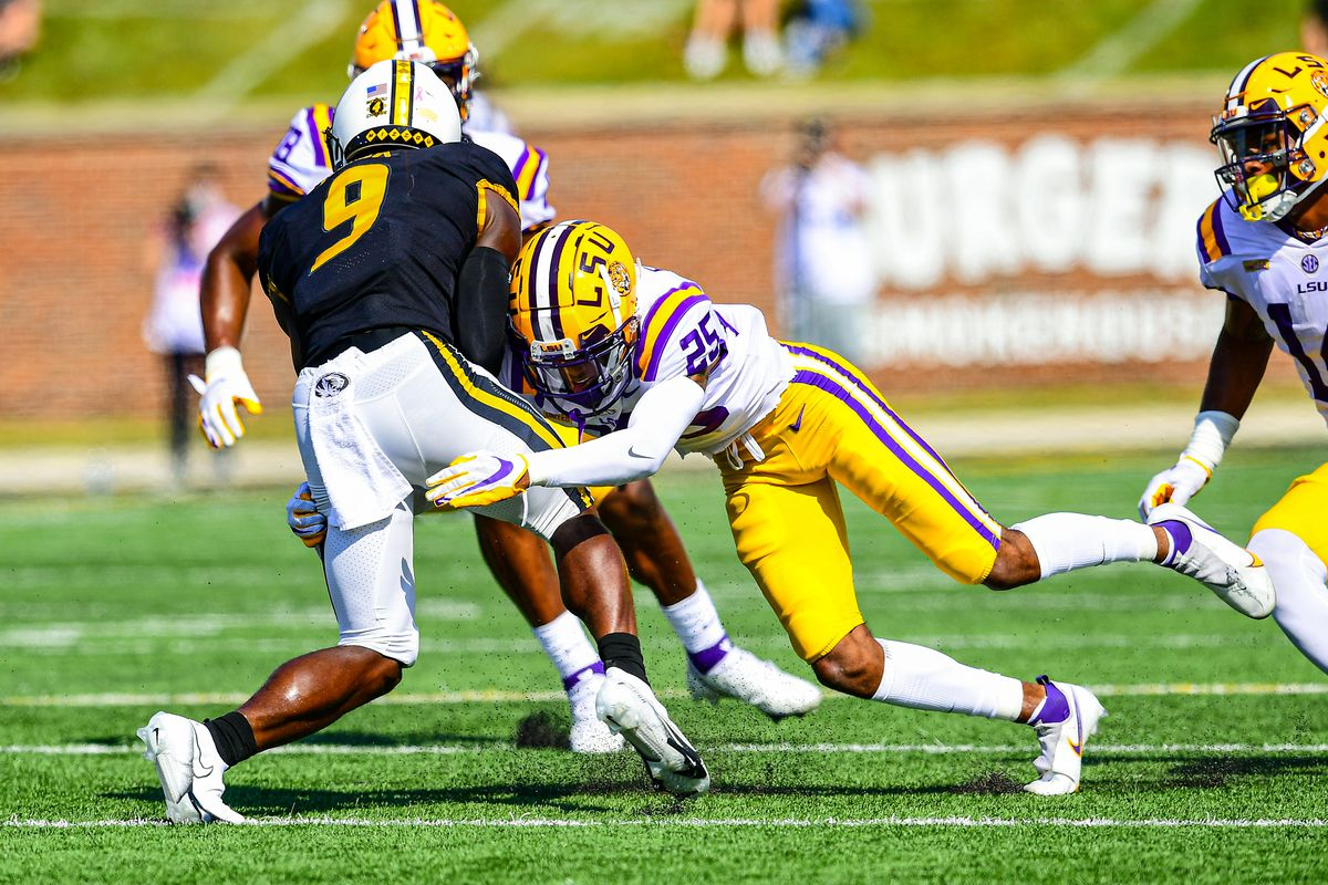 Cordale Flott of the LSU Tigers makes a tackle against the Missouri Tigers on October 10, 2020 at Memorial Stadium in Columbia, Missouri.