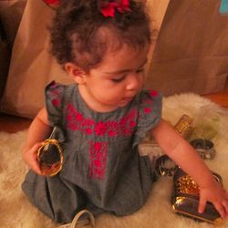 Alaia playing with mommy's to-die-for accessories.
