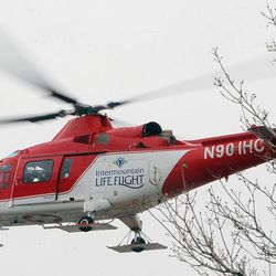 Life Flight arrives on scene as emergency crews respond Tuesday, Dec. 2, 2014, to a helicopter crash in North Salt Lake.