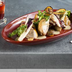 Wood-Roasted Locust Point Chicken— Hearty greens and sweet onion salad, shmaltz vinaigrette
