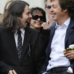 Former Beatle George Harrison's son Dhani, left, shares a laugh with Paul McCartney during a posthumous Hollywood Walk of Fame star dedication for the late Beatle Harrison in Los Angeles, Tuesday, April 14, 2009. (AP Photo/Chris Pizzello)
