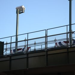Sun 4:04 p.m. Scaffolding set up in the left field bleachers, behind Section 302 -