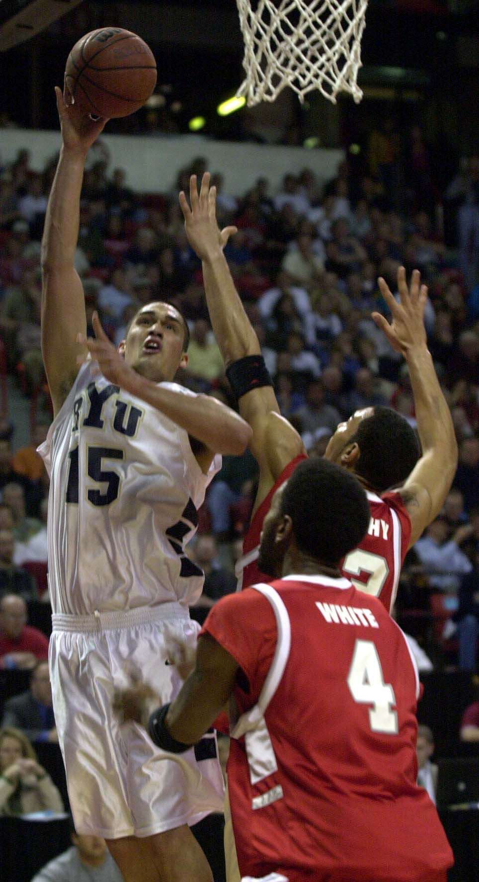 BYU's Mekeli Wesley attempts a shot against Wayland White and Patrick Dennehy of New Mexico at the MWC Tournament in Las Vegas, March 10, 2001.