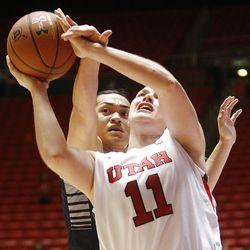 Utah's Taryn Wicijowski, right, is fouled by Utah State's Franny Vaaulu under the basket as Utah and Utah State play Nov. 27, 2012, in the Huntsman Center. Utah won 92-64.