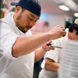 Dave Chang plating his oyster dish