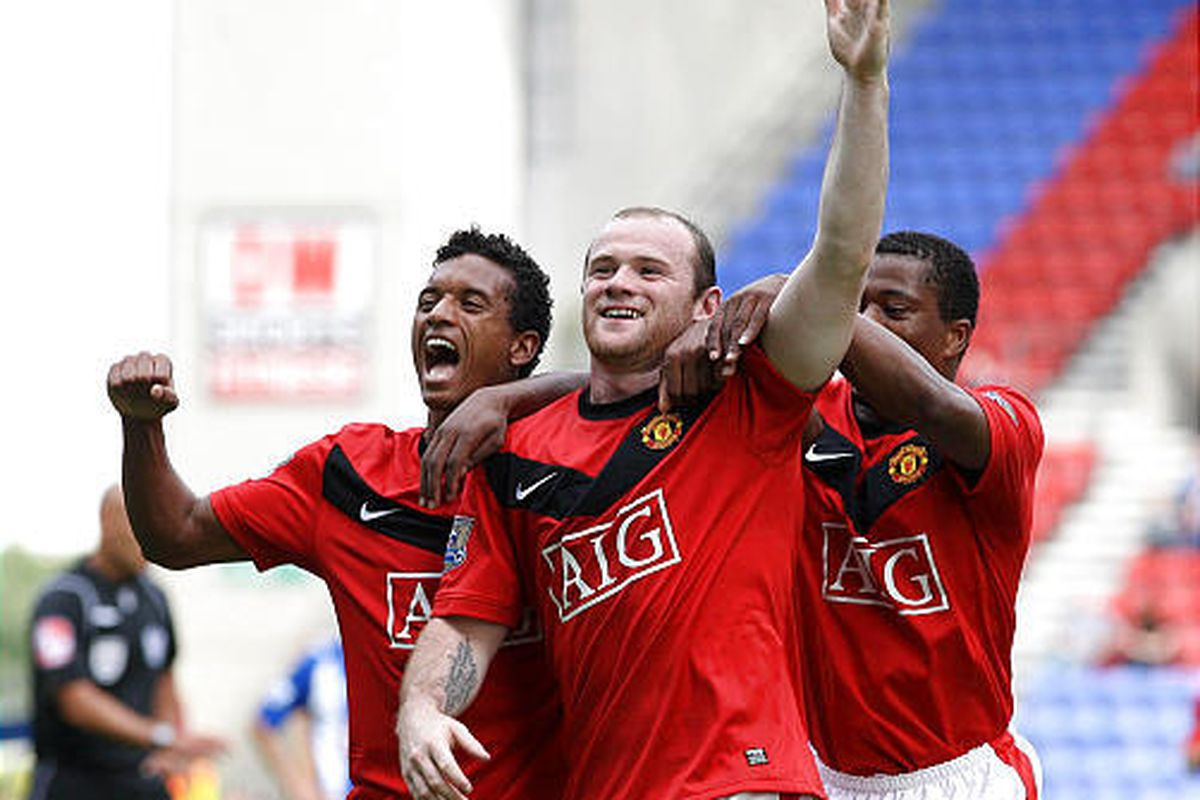 Manchester United's Wayne Rooney celebrates scoring his second goal against Wigan during the Premier League match at the DW Stadium.