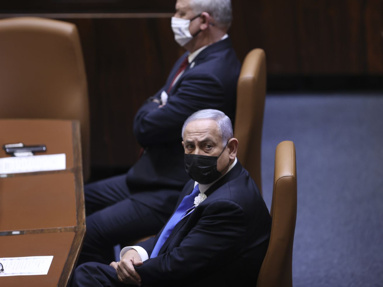 Israeli Prime Minister Benjamin Netanyahu, front, attends the swearing-in ceremony for Israel's 24th government, at the Knesset, or parliament, in Jerusalem, Tuesday, April 6, 2021. The ceremony took place shortly after the country's president asked Netanyahu to form a new majority coalition, a difficult task given the deep divisions in the fragmented parliament.