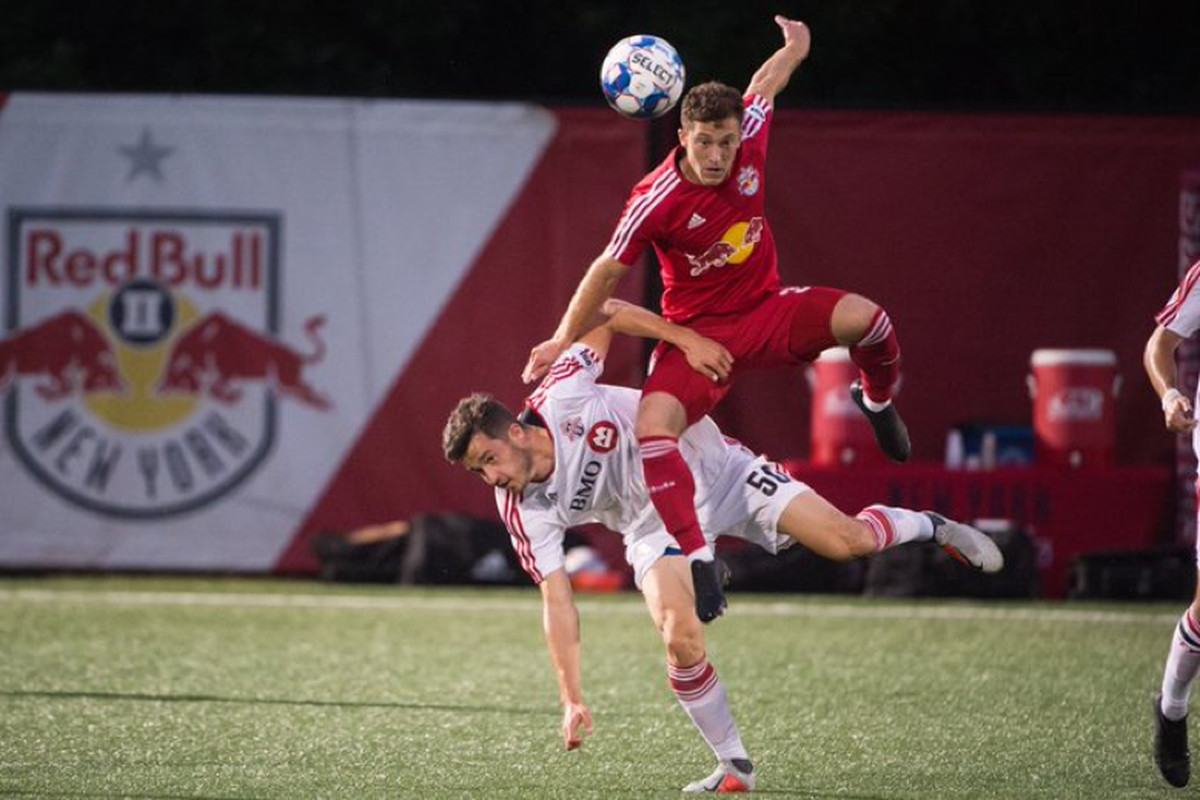 USL Photo - Toronto FC II's Matt Srbely gets tangled up with an opponent in their 3-3 draw with New York Red Bulls II at MSU Soccer Park on Thursday night