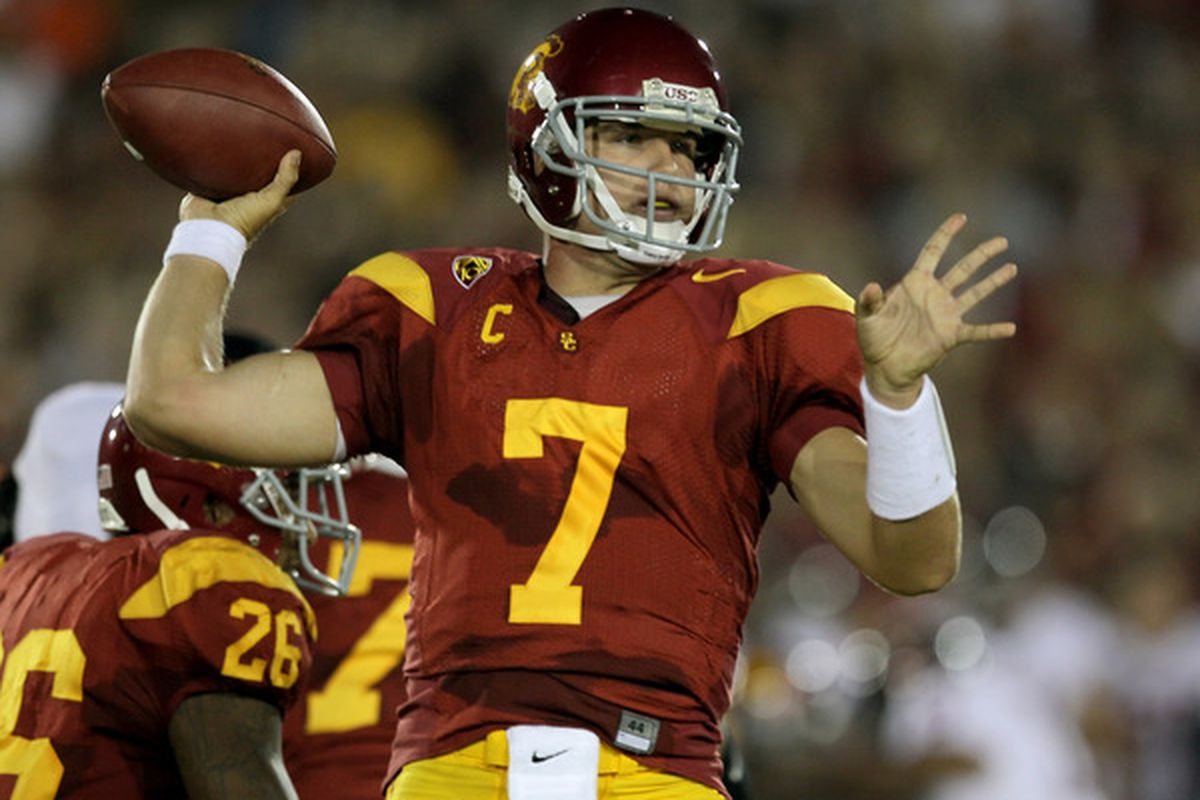 LOS ANGELES - SEPTEMBER 11:  Quarterback Matt Barkley, seen here thinking about Reddit while effortlessly throwing a touchdown pass with his perfect hands. (Photo by Stephen Dunn/Getty Images)
