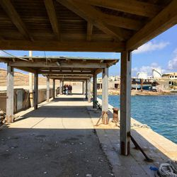 The docks at Lampedusa are where refugees are unloaded from rescue ships.