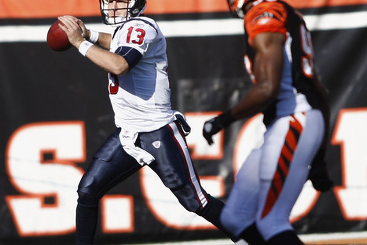 CINCINNATI, OH - DECEMBER 11:  T.J. Yates #13 of the Houston Texans drops back to pass during the game against the Cincinnati Bengals at Paul Brown Stadium on December 11, 2011 in Cincinnati, Ohio.  (Photo by John Grieshop/Getty Images)