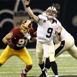 New Orleans Saints quarterback Drew Brees (9) passes in the first half of an NFL football game against the Washington Redskins at Mercedes-Benz Superdome in New Orleans, Sunday, Sept. 9, 2012.