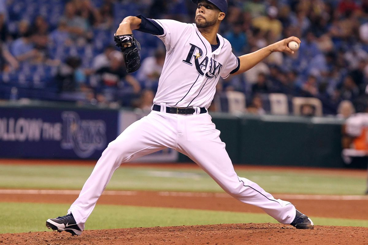 May 4, 2012; St. Petersburg, FL, USA; Tampa Bay Rays starting pitcher David Price (14) throws a pitch in the fifth inning against the Oakland Athletics at Tropicana Field. Mandatory Credit: Kim Klement-US PRESSWIRE