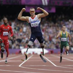 Britain's Richard Whitehead celebrates after winning the men's 200m T42 final race at the 2012 Paralympics in London, Saturday, Sept. 1, 2012.