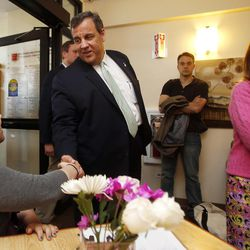 Stephanie Rhodes, left, shake hands with New Jersey Gov. Chris Christie, R-N.J., accompanied by his wife Mary Pat, as they arrive for a roundtable discussion at the Farnum Center, Thursday, May 7, 2015, in Manchester, N.H.