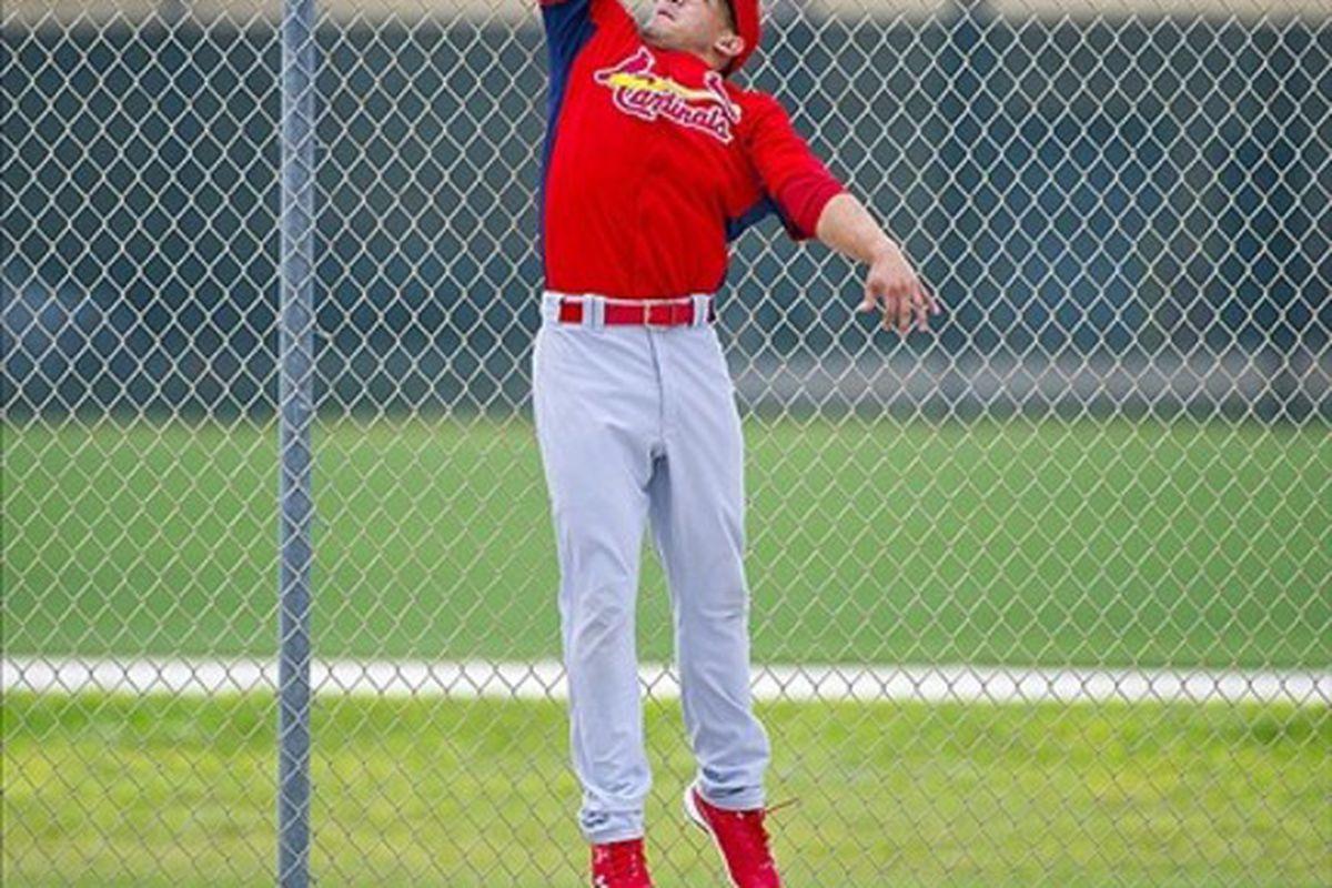 Feb 26, 2012; Jupiter, FL. USA; St. Louis Cardinals right fielder Erik Komatsu (82) makes a leaping catch during workouts at Roger Dean Stadium. Mandatory Credit: Scott Rovak-US PRESSWIRE