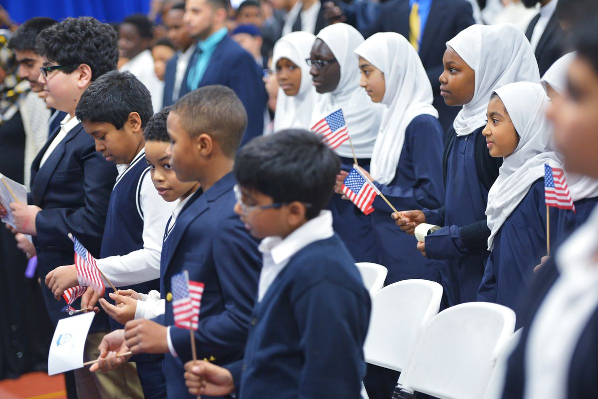 Children Hold Us Flags As Us President Barack Obama Speaks In An Overflow Room During A Visit To The Islamic Society Of Baltimore In Windsor Mill