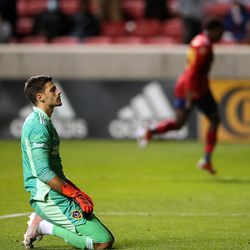 Los Angeles Galaxy goalkeeper Jonathan Bond (1) reacts in disappointment as Real Salt Lake midfielder Anderson Julio (29) celebrates in the background as Real Salt Lake and LA Galaxy play at Rio Tinto Stadium in Sandy on Wednesday, Sept. 29, 2021. RSL won 2-1.