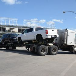 3:16 p.m. Car carrier with player's cars, maneuvering at Clark and Waveland -