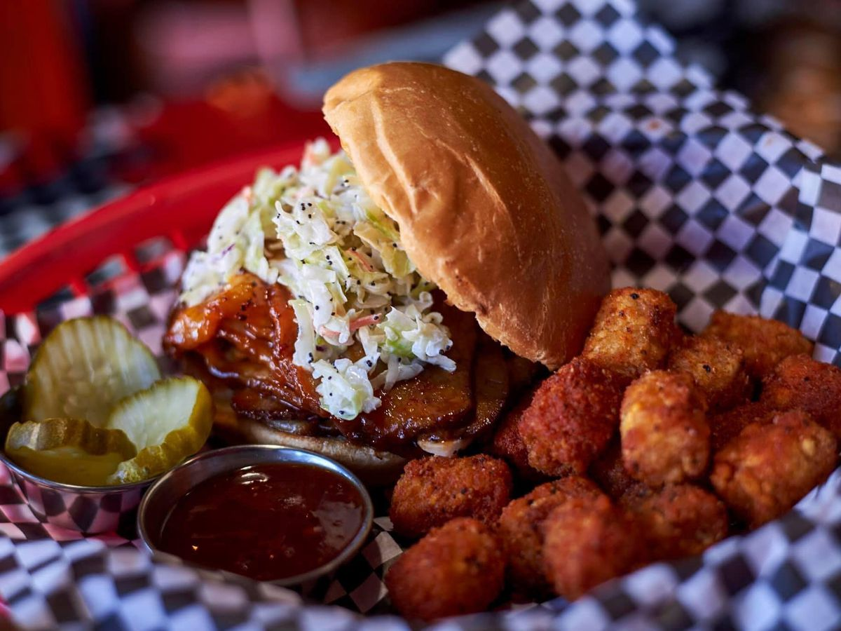 Brisket sandwich with tater tots in basket