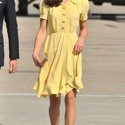 In Canada on July 7th, 2011 wearing a yellow Jenny Packham dress with nude L.K. Bennett pumps.