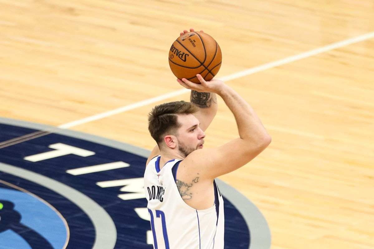 Dallas Mavericks guard Luka Doncic shoots the ball in the second half against the Minnesota Timberwolves at Target Center.